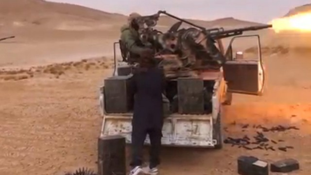 A still image purports to show Islamic State fighters advancing over the Hayan mountain south of Palmyra