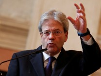 Italian Foreign Minister Paolo Gentiloni gestures as he talks during a joint press conference with Russian Foreign Minister Sergei Lavrov in Rome