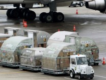 United Parcel Service air craft are being loaded and unloaded with air containers full of packages bound for their final destination at the UPS Worldport All Points International Hub during the peak delivery season in Louisville