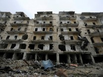Damaged buildings are seen in the government-held al-Shaar neighborhood of Aleppo