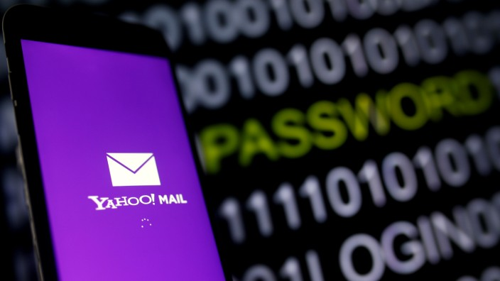 Yahoo Mail logo is displayed on a smartphone's screen in front of code in this illustration picture