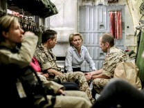 German Defence Minister von der Leyen talks aboard a German Air Force plane on the way from Jordan to Iraq