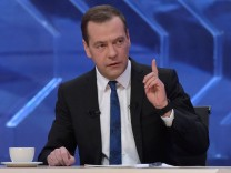 Russia's PM Medvedev gives an interview to Russian TV channels in Moscow