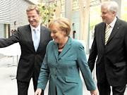 Westerwelle, Merkel, Seehofer, dpa