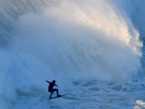 German big wave surfer Sebastien Steutner drops a wave off Praia do Norte in Nazare, central Portugal,