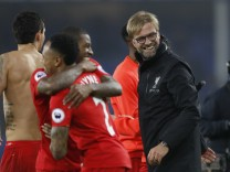 Liverpool manager Juergen Klopp celebrates after the match with their players