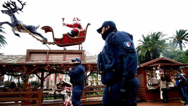 Police officers patrol the Nice Christmas market