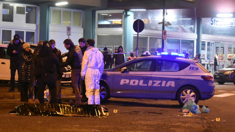 Italian Police officers work next to the body of Anis Amri, the suspect in the Berlin Christmas market truck attack, in a suburb of the northern Italian city of Milan