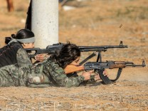 Female fighters of the Kurdish People's Protection Units participate in a military training in the western countryside of Ras al-Ain