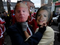 People costumed as Donald Trump and Hillary Clinton are seen during an Irish tradition of Hunting of the Wren festival held every St. Stephen's Day