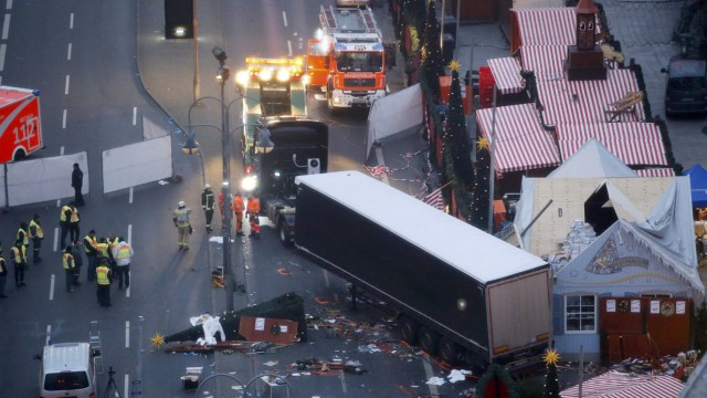 A tow truck operates at the scene where a truck ploughed through a crowd at a Berlin Christmas market