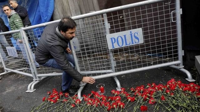 Man lays flowers outisde the Reina nightclub by the Bosphorus, which was attacked by a gunman, in Istanbul