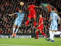Liverpool's Georginio Wijnaldum scores their first goal