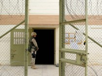 U.S. SOLDIER GUARDS ABU GHRAIB PRISON IN BAGHDAD