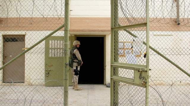 U.S. SOLDIER GUARDS ABU GHRAIB PRISON IN BAGHDAD