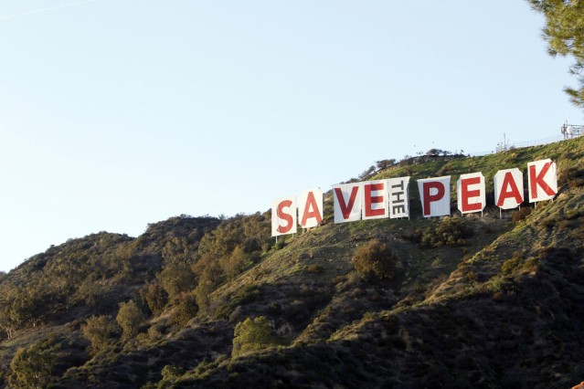 A temporary draping of the Hollywood sign that reads 'Save the Peak' is seen in Los Angeles