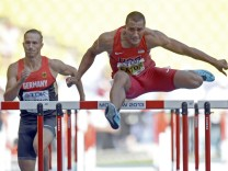 Eaton of the U.S. clears a hurdle next to Schrader of Germany in their men's decathlon 110 metres hurdles event during the IAAF World Athletics Championships in Moscow