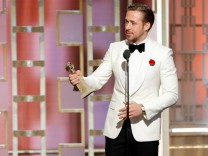 Actor Ryan Gosling holds his award for Best Actor, Motion Picture - Musical or Comedy for 'La La Land' during the 74th Annual Golden Globe Awards show in Beverly Hills