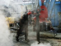 File photo of employee working on drilling rig at Lukoil-owned Imilorskoye oil field outside Kogalym