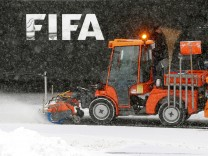 A street sweeper removes snow in front of FIFA headquarters in Zurich