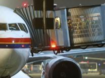 German federal police officers prepare German's first group deportation of rejected asylum seekers at Frankfurt airport