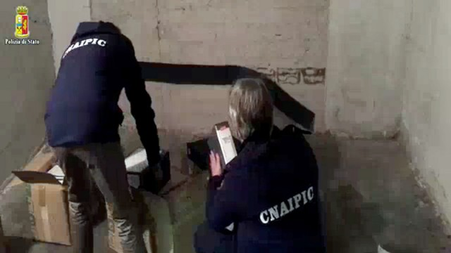 Police officers search documents in Rome