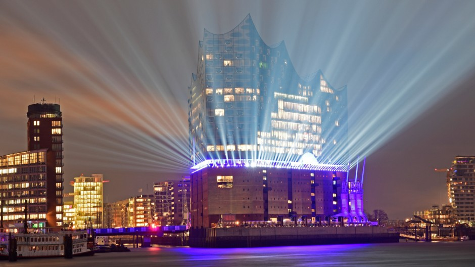 The 'Elbphilharmonie' is illuminated during a light test in downtown Hamburg