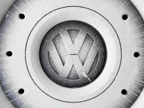 FILE PHOTO: A Volkswagen logo is seen on the wheel of a car in Grafenwoehr