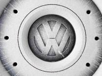 FILE PHOTO: A Volkswagen logo is seen on the wheel of a car in Grafenwoehr