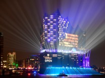 The new philharmonic hall Elbphilharmonie is illuminated during its opening ceremony in Hamburg