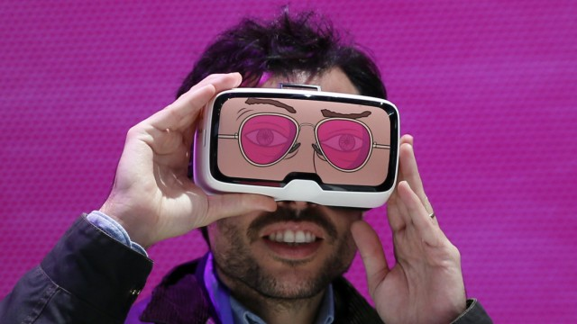 A man tests the 'Zeiss VR One' virtual reality glasses during the Mobile World Congress in Barcelona