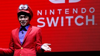 Nintendo's Yoshiaki Koizumi, wearing game character Super Mario's attire, speaks at a presentation ceremony of the Switch, Nintendo's new game console, in Tokyo