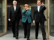 dpa, Guido Westerwelle, Angela Merkel, Horst Seehofer