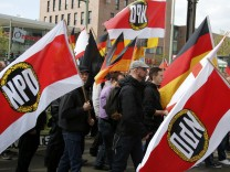 Supporters and members of the far-right National Democratic Party (NPD) march during a demonstration on May Day in Berlin