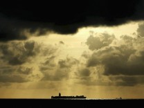 File photo of a container ship sailing towards Colombo Harbour as the sun sets in Colombo, Sri Lanka