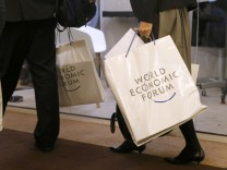 Attendees walk in the Congress Hall during the WEF in Davos