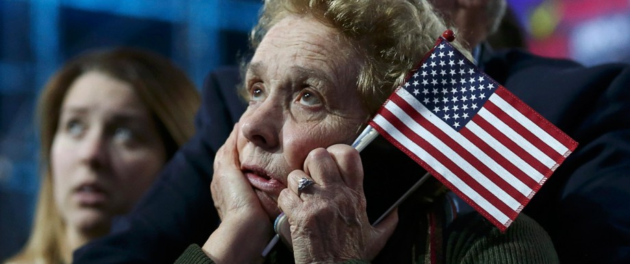 Supporters of Democratic presidential nominee Hillary Clinton watch and wait at her rally in New York