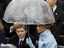 Melania and Barron Trump shield under an umbrella during the inauguration ceremonies to swear in Donald Trump as the 45th president of the United States at U.S. Capitol in Washington