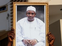 A supporter of president-elect Adama Barrow holds his portait during his inauguration at Gambia's embassy in Dakar, Senegal