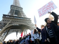 Protesters take part in the Women's March in Paris, France