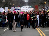 Protesters participating in the Women's March on Washington move up 17th Street Northwest after U.S. President Donald Trump's motorcade returned to the White House in Washington