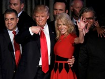 U.S. President-elect Donald Trump and his campaign manager Kellyanne Conway greet supporters during his election night rally in Manhattan