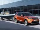 Land Rover Discovery Front Seite Fahrbild mit Bootsanhaenger