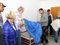 Asylanten beziehen Appartements