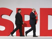 Leader of the SPD Gabriel and European Parliament President Schulz walks on the podium during party congress in Berlin