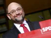 Former president of the European Parliament Schulz smiles during a news conference in Berlin