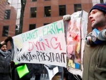 Demonstrators gather protesting climate change outside the office of U.S. Senator Charles Schumer (D-NY) in New York
