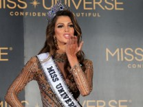 Newly-crowned Miss Universe Iris Mittenaere from France blows a kiss during a news conference inside a Mall of Asia arena in metro Manila