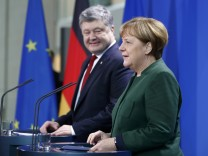 German Chancellor Merkel and Ukraine's President Poroshenko address a news conference in Berlin
