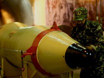 Member of the Iranian Revolutionary Guards checks a missile inside an underground depot in an undisclosed location, Iran, in this handout photo released by the official website of Islamic Revolutionary Guard Corps
